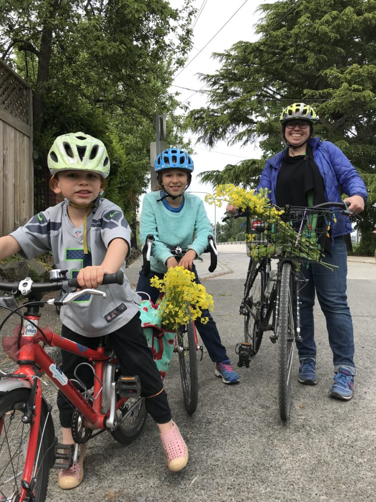 A family with kids riding bikes on their own!